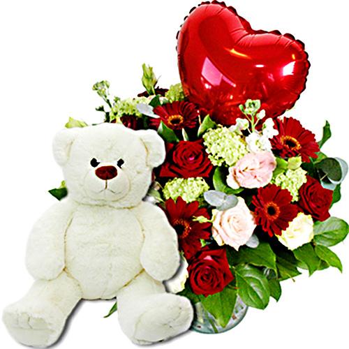De Feestdagen | Valentijnscadeau met witte knuffelRood roze boeket met een groot rood hart erin met daar bij een kwaliteits knuffel van Anna pluche 45cmDoor beschikbaarheid van bloemen kan het boeket afwijken van de fotoEen kaartje met persoonlijke tekst